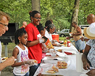 MADELYN P. HASTINGS | THE VINDICATOR..Guests line up to fill their plates at the Youngstown National Night Out at Wick Park on August 6, 2013. This is part of National Night Out program, dedicated to the development and promotion of various crime-prevention programs including neighborhood watch groups, law enforcement agencies, state and regional crime prevention associations, businesses, civic groups, and individuals, devoted to safer communities.... - -30-..