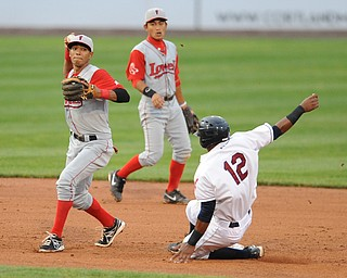 Lowell second basemen #5 Deiner Lopez prepares to throw the ball to first base after stepping on second base to force out Scrappers base runner #12 Claudio Bautista to turn the double play to end the 4th inning.