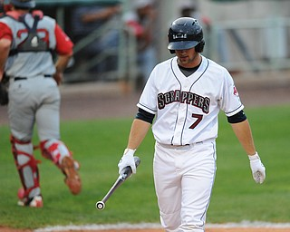 Scrappers batter #7 Josh McAdams  walks back to the dugout after striking out to end 4th inning. Lowell catcher #23 Danny Bathea