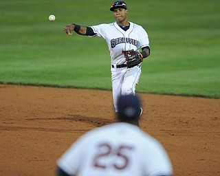 Scrappers second basemen #12 Claudio Bautista throws the ball to first basemen #25 Nellie Rodriguez for the out.