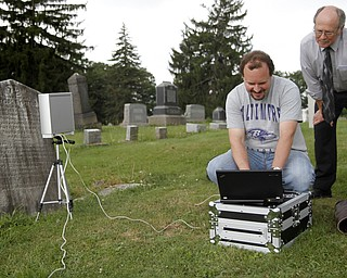 MADELYN P. HASTINGS | THE VINDICATOR  (L-R) Matt O'Mansky and Jerry Ward look at the results of a 3-D scan of the eroded tombstone of George Foulkes. O'Mansky is using the scanner to try to make out the words on the tombstone in the Glenview Cemetery in East Palestine. O'Mansky  was contacted by Ward, who is a descendant of Foulkes. Foulkes was captured by Indians as a young boy in 1780 and remained a captive for 11 years before escaping.