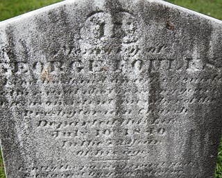 MADELYN P. HASTINGS | THE VINDICATOR  The tombstone of George Foulkes in the Glenview Cemetery in East Palestine. Matt O'Mansky is using a 3-D scanner to try to make out the words on athe tombstone.  O'Mansky  was contacted by a descendant of George Foulkes, who the tombstone is dedicated to. Foulkes was captured by Indians as a young boy in 1780 and remained a captive for 11 years before escaping.