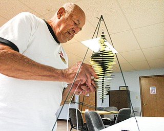 ROBERT K. YOSAY  | THE VINDICATOR    Ed Gabrick  builds a whirly jig Senior Independence Adult Day Care 1393 Boardman Canfield Rd is the new digs for the people who used to be clients at the Mahoning County Adult Day Care Program.