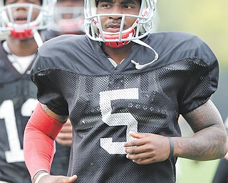 Braxton Miller warms up during practice on Wednesday. OSU officials said the quarterback has been cleared of any NCAA violations.