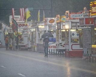 MADELYN P. HASTINGS | THE VINDICATOR  Rain and flooding delayed the Warren Italian Festival on Thursday, August 8. The festival runs through Sunday.