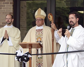 ROBERT K. YOSAY  | THE VINDICATOR  Deacon John Ettinger  Bishop Murry and  Father Greg Maturi at the opening and blessing of the new hall   St Dominic's New Parish Center  was officially opened today on Southern Blvd. It coincided with the 90th birthday of the church and presided over by Bishop george  Murry