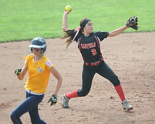 Canfield infielder #3 Mia Kindinis throws the ball to first base for the third out in the top of the 7th inning Michigan base runner #18 Rachel Pijaszek.
