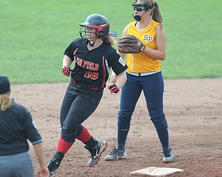 Canfield base runner #16 Amelia Manenti rounds second base after hitting a double in the bottom of the bottom of the 8th inning. Michigan infielder #9 Lexie Hughes.