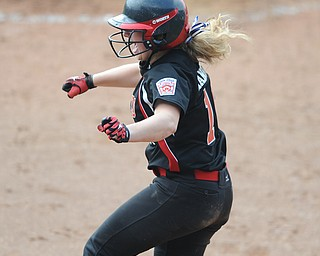 Canfield base runner #16 Amelia Manenti  jumps in the air after scoring the game winning run in the bottom of the 8th inning.