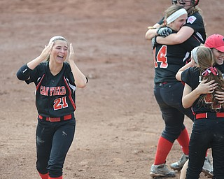 Canfield player #21 Ellie Dundics walks around the infield in disbelief after the game winning run in the bottom of the 8th inning. While teammates #2 Maddy Johns, #14 Jenna Gibson, and #4 Maura Kennedy (woman in red is a coach, name not on the lineup card I have).