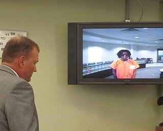 Atty. Mark Hanni, left, and Traci Timko Rose, an assistant Warren law   director, stand before a video monitor in Warren Municipal Court   Thursday with his client, Lakeisha Bell, 19, of Williamsburg Street   Northwest. Bell is charged with involuntary manslaughter, carrying a   concealed weapon and being a felon in possession of a firearm in the   Aug. 2 death of her friend, McKayla Hopkins, 18. Police say Bell   accidentally shot Hopkins during Bell's birthday party in Perkins Park.