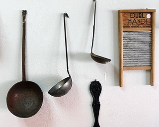 ROBERT K. YOSAY    THE VINDICATOR..kitchen utensils.Larry and Ann Canale have been running an antiques business for more than five years. Their operation started from a small house in Columbiana, but has since expanded to a storefront there with 6,000 square feet. A feature on their business and how theyÕve managed to grow.--AnnÕs Attic Antiques & Furniture,  Columbiana.... - -30-..