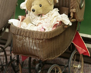 ROBERT K. YOSAY  | THE VINDICATOR..wicker stroller..Larry and Ann Canale have been running an antiques business for more than five years. Their operation started from a small house in Columbiana, but has since expanded to a storefront there with 6,000 square feet. A feature on their business and how theyÕve managed to grow.--AnnÕs Attic Antiques & Furniture,  Columbiana.... - -30-..