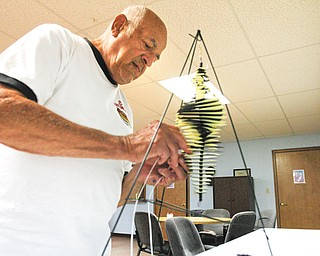 Edward Gabrick builds a Whirly Jig at the Senior Independence Adult Day Care Center in Boardman, the new home for people who used to be clients of the Mahoning County Adult Day Care program operated by the district board of health.