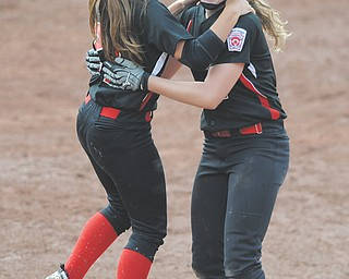 Canfield's Ellie Dundics, left, hugs teammate Maddy Johns (2) after Johns batted in the game-winning run