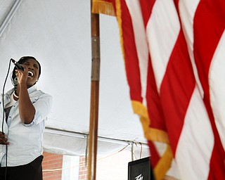 MADELYN P. HASTINGS | THE VINDICATOR..Joselyn Parker of Youngstown sings the national anthem during the Community Cup opening ceremonies at the Central YMCA in downtown Youngstown on Friday, August 9, 2013.. ... - -30-..