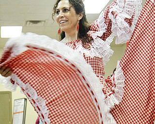MADELYN P. HASTINGS   THE VINDICATOR..Paulina Montaldo of Youngstown dances during the 2nd Annual International Latino Food Fest at the OCCHA Social Hall in Youngstown on Friday, August 9, 2013. ... - -30-..