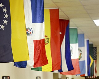 MADELYN P. HASTINGS | THE VINDICATOR..Lined along the ceiling are flags to represent Colombia, Cuba, Dominican Republic, Mexico, Peru, and Puerto Rico at the 2nd Annual International Latino Food Fest at the OCCHA Social Hall in Youngstown on Friday, August 9, 2013. ... - -30-..