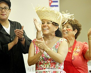 MADELYN P. HASTINGS | THE VINDICATOR..(L-R) Vanessa Flores, Dr. Consuelo Mendez and Rachel Flores-Flasco clap and sing during the 2nd Annual International Latino Food Fest at the OCCHA Social Hall in Youngstown on Friday, August 9, 2013. ... - -30-..