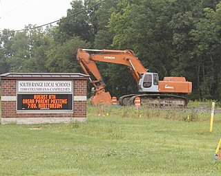 ROBERT K. YOSAY  | THE VINDICATOR..Work has begun on the tunnel for South Range Students  to travel under St Rt  46 which will be shut down for several weeks as it is intstalled.- The plan is to have install turn lanes too-- ODOT says - SR 46 between Cook Rd. and W. Middletown Rd. is closed through late August for a culvert replacement. The detour is SR 11 to US 224. This work is the beginning of a $750,000 project to add turn lanes and a pedestrian tunnel at SR 46 at South Range School District. The entire project is scheduled to be completed by late October 2013.. . ... - -30-..
