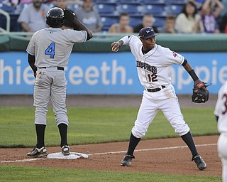 Scrappers third basemen #12 Claudio Bautista prepares to throw the ball around after tagging out Hudson Valley base runner #4 Ariel Soriano who was attempting to steal third base in the top of the 5th inning on August 9, 2013.
