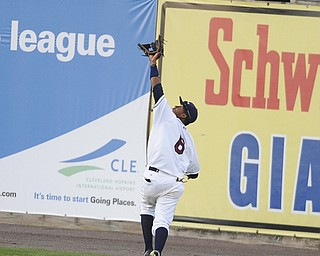 Scrappers outfielder #6 Joel Mejia sticks his glove up to catch a deep fly ball hit to the outfield in the top of the 5th inning, he would make the catch on August 9, 2013.