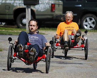 MADELYN P. HASTINGS | THE VINDICATOR..(L-R) Travis and Wayne Wallace take a ride in two of their adult tricycles outside of their store in Lisbon, Rail to Trail. The store in No. 1 in the world for sales of the Catrike tricycles. .... - -30-..