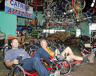 MADELYN P. HASTINGS | THE VINDICATOR...(L-R) Travis and Wayne Wallace pose in their adult tricycle store in Lisbon, Rail to Trail. The store in No. 1 in the world for sales of the Catrike tricycles. .. - -30-..