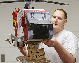 ROBERT K. YOSAY  | THE VINDICATOR..Logan with his H-60  Jay Hawk helicopter Logan, a young adult at Gateways to Better Living, is considered by staff members to be a noteworthy artist ....... - -30-..