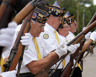 MADELYN P. HASTINGS | THE VINDICATOR..Vince Bellanca of Lowellville participates in a 21-gun salue honoring local veterans who died in combat during World War II and the Vietnam War. The dedication was part of Lowellville Day on Saturday, August 10, 2013 in downtown Lowellville. ... - -30-..