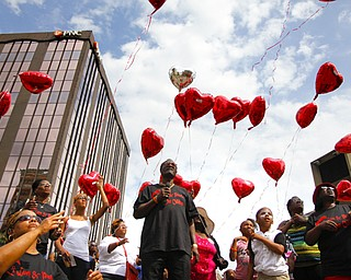 MADELYN P. HASTINGS | THE VINDICATOR..Several people release balloons in honor of loved ones killed in violence during the ÒLetÕs MoveÓ block party in downtown Youngstown on Saturday, August 10, 2013. The block party was a health-oriented activity, from 10 a.m. to 5 p.m. focused on Michelle ObamaÕs project of physical activity Ñ ÒLetÕs Move.Ó The party featured zumba, line dancing, basketball and an obstacle course. ... - -30-..