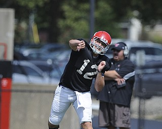 Youngstown State running back #12 Kurt Hess throws a pass from the pocket during a scrimmage on August 10, 2013.