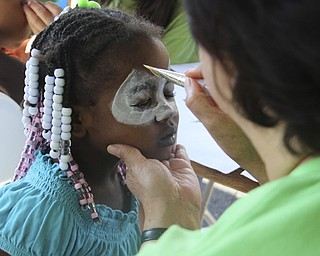 Jalaya Bumm (4) of Youngstown gets her face painted during the Goodness Invasion at the Covelli Center in Youngstown on Saturday morning.  Dustin Livesay  |  The Vindicator  8/10/13 Covelli Center.