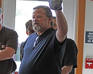 Dan Baker of Sebring holds up a footprint cast of a Big Foot during a Big Foot Research Group meeting at the Leetonia Community Public Library in Leetonia on Saturday Morning.  Dustin Livesay  |  The Vindicator  8/10/13  Leetonia Community Public Library.