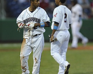 Scrappers base runner #6 Joel Mejia taks off his batting gloves after being picked off at first base to end the bottom of the 4th inning during a game between the Scrappers and Renegades on August 10, 2013.  First base coach #2 Robel Garcia pictured.