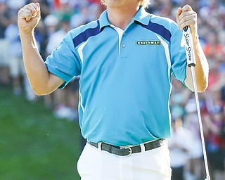 Jason Dufner celebrates winning the PGA Championship on Sunday at Oak Hill Country Club in Pittsford, N.Y. It was the first major win for Dufner, a Cleveland native.