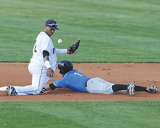 Renegades baserunner Johnny Field safely steals second base as the ball gets away from Scrappers infielder Claudio Bautista during the fourth inning of a New York-Penn League baseball game Sunday at Eastwood