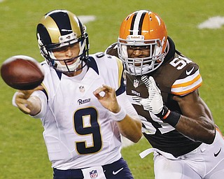 St. Louis Rams quarterback Austin Davis (9) gets rid of the ball as he is chased by Cleveland Browns linebacker Barkevious Mingo (51) in the third quarter of a preseason game on Thursday. Mingo was a force in his NFL debut as the Browns beat the Rams, 27-19.