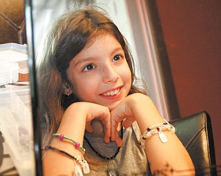 Talia Vale Mollica, the 9-year-old daughter of Kristen and Dominic Mollica of Canfield, recently started her own business, Bling Dazzles, to sell the jewelry she designs. Each piece is unique, and comes with a name and a story that explains her inspiration. Talia has made about 300 one-of-a-kind pieces.