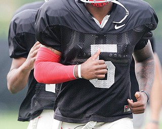 Ohio State quarterback Braxton Miller warms up during a practice in Columbus. Miller is famous in Ohio, but he says he has no intention of allowing his celebrity to change who he is as a person.