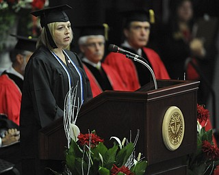 Angela Cameron speaks at the podium during the student reflection speech during the summer commencement ceremony Saturday morning at Beeghley Center.