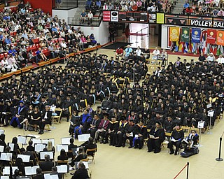 Graduates sit on the floor during the student reflection during the summer commencement ceremony Saturday morning at Beeghley Center.