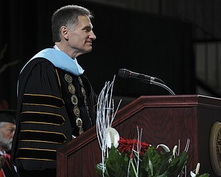 Youngstown State president Randy Dunn speaks at the podium before the presentation of diplomas during the summer commencement ceremony Saturday morning at Beeghley Center.