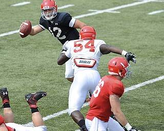 Youngstown State quarterback Kurt Hess #12 is flushed from the pocket by defensive linemen #54.