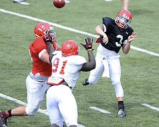 Youngstown State quarterback #3 Dante Nania throws a pass from the pocket avoiding the pass rush from #91 Mike Palumbo.