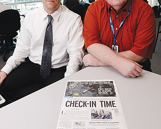Publisher Ian Lamont, right, and editor Paul Eakins show a prototype Page One in the Long Beach Register newsroom as the staff prepares for its first day of publication at its office in Long Beach, Calif. Published by the Orange County Register, the Long Beach Register makes its five-day-a-week debut today.