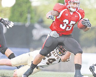 YSU's Jamaine Cook (35) drags Valparaiso's Patrick Derbek (24) during a Youngstown State game last season at Stambaugh Stadium. Cook has returned to the Cleveland Browns after being cut in May.
