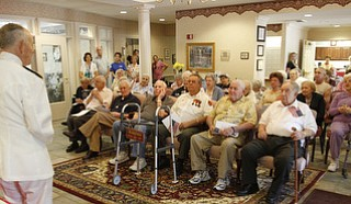 Admiral Kenneth Monroe Carr, 88,of Chagrin Falls,  tells of his 46-year military service to residents of Windsor House.