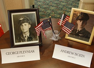 A photo with the names and flags of World War II veterans at Windsor House at Liberty Arms was displayed at Crossroads Hospice's service honoring vets.