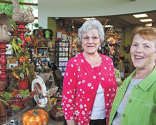 Beverly Italiano, left, and Carolyn Little are members of the Lizzies, a group of employees, volunteers and benefactors of Fellows Riverside Gardens that supports Fellows as a social organization. WILLIAM D. LEWIS | THE VINDICATOR